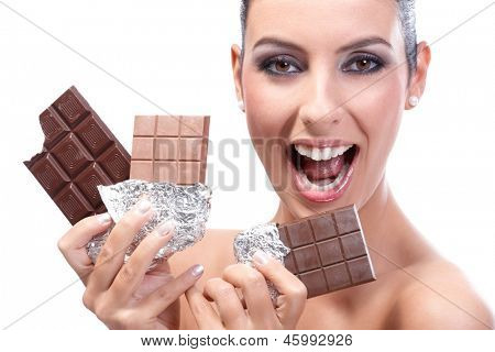 Happy young woman holding three chocolate bars in hand, smiling happily.