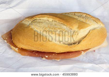 Spanish serrano ham sandwich on a napkin on a table