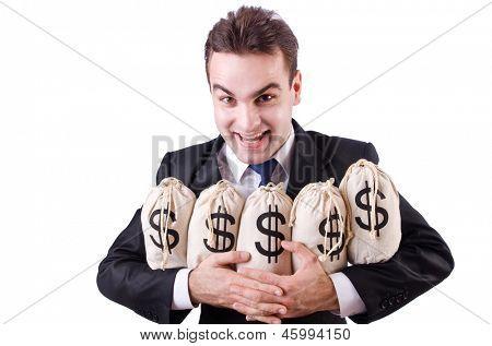Businessman with sacks of money on white