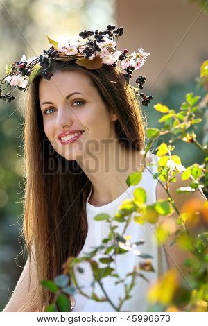 Portrait Of A Beautiful Smiling Girl With Flower Crown