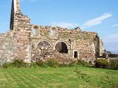 This image was taken on Iona a small island of the West coast of Scotland. THis is a picture of the ruins of an old Nunnery found near Iona Abbey. poster