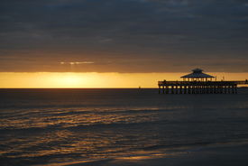 Fort Myers Beach And Pier At Sunset