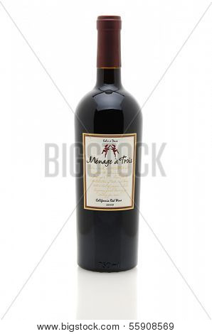 IRVINE, CA - JANUARY 11, 2013: A 750 ml bottle of Menage a Trois California Red Wine. Produced by the award winning winery Folie a Deux in Sonoma.