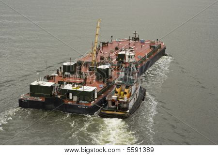 Tug with a barge.