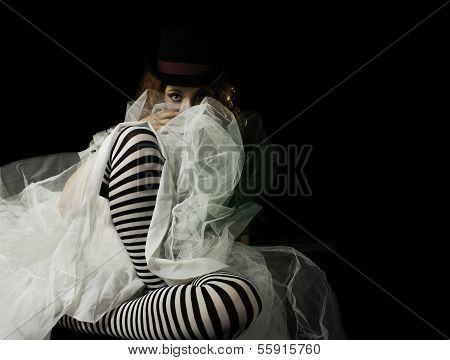 Beautiful young woman wearing striped stockings and crinoline