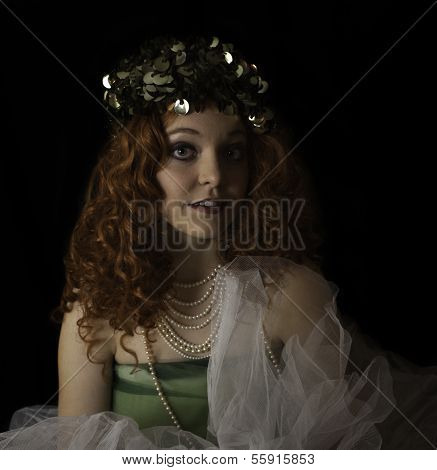 Beautiful young woman wearing crinoline and pearls