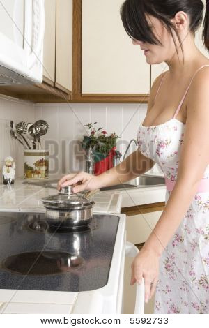 Housewife In The Kitchen