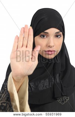 Arab woman making stop gesture with her hand isolated on a white background poster
