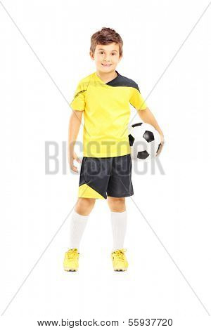Full length portrait of a kid in sportswear holding a soccer ball isolated on white background