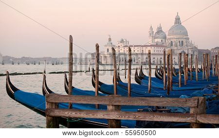 Gondolas On Salute Church Background