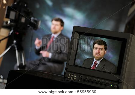 Monitor In Production Studio Showing Man Talking Into A Television Camera