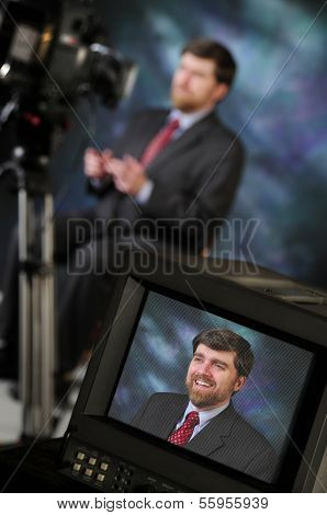 Monitor in production studio showing newsman or pundit talking to television or video camera poster