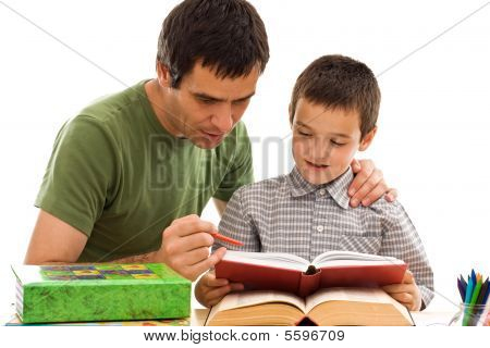 Schoolboy And His Father Learning