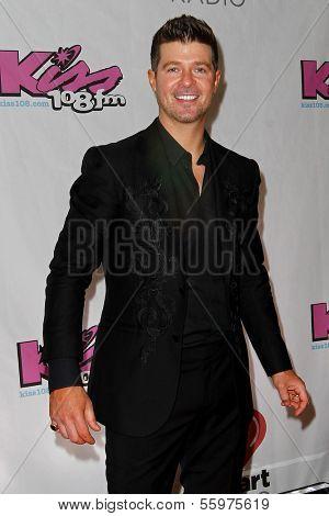 BOSTON-DEC 14: Singer Robin Thicke attends KISS 108's Jingle Ball 2013 at TD Garden on December 14, 2013 in Boston.