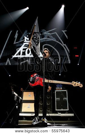 BOSTON-DEC 14: Bassist Pete Wentz of Fall Out Boy performs at KISS 108's Jingle Ball 2013 at TD Garden on December 14, 2013 in Boston.