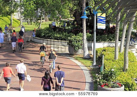 People Walking And Biking At Riverwalk