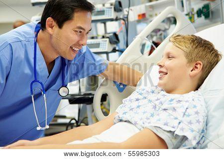 Boy Talking To Male Nurse In Emergency Room
