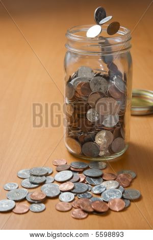 Dropping Coins Into A Jar