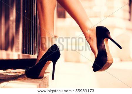 woman legs in high heel shoes outdoor shot