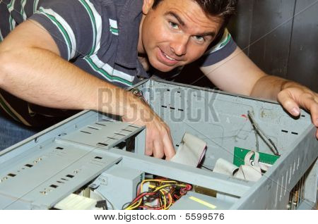 Picture Of Male Working On Fixing Old Pc Server
