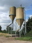 A Pair of Agricultural Animal Feed Hoppers. poster