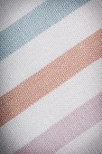 Closeup of colorful striped fabric textile as background texture or pattern. Macro. poster