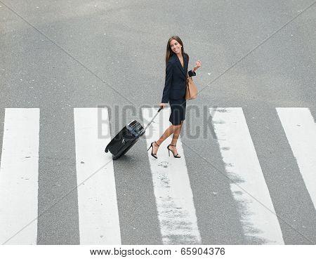 Businesswoman Crossing Street At Crossway