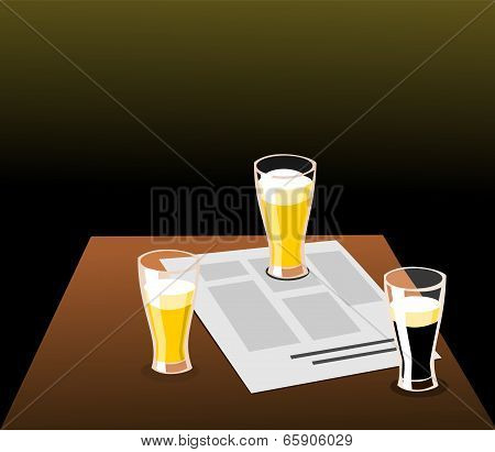 Three beers and newspaper on a table