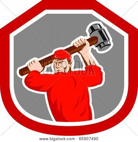 Illustration of a union worker striking using smashhammer hammer done in retro style set inside shield crest on isolated white background. poster