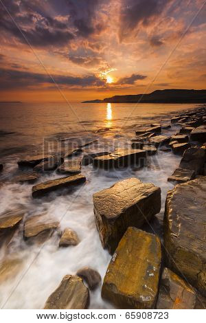 Waves wash over the rocks at Kimmeridge in Dorset