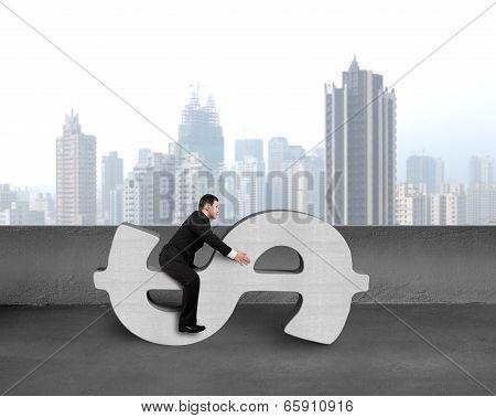 Businessman Sitting On Concrete Money Symbol