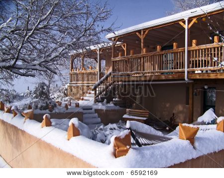 Southwestern house in snow