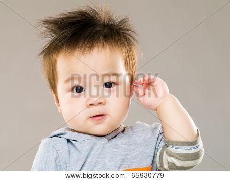 Cute baby boy salute