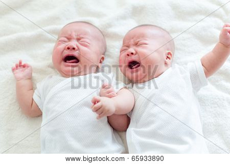 Twins brother baby crying