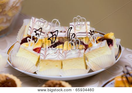 Sweet Food. Pieces Of Cakes On Plate.