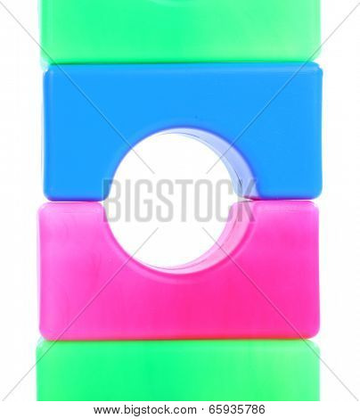 Plastic colorful blocs isolated on white