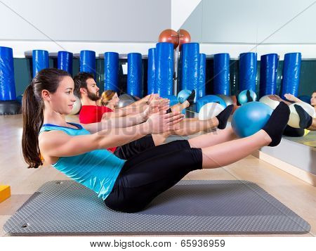 Pilates softball the teaser group exercise at fitness gym