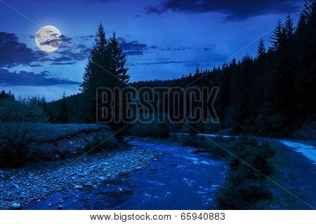 Road Near The Forest River At Night