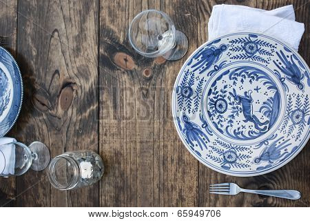 Rustic meal setting on Table with dark grain poster