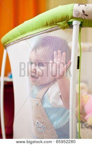 Baby In Playpen