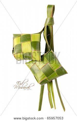 Muslim Ketupat (Rice Dumpling) with Clipping Path. Translation: Eid Mubarak - Blessed Feast poster