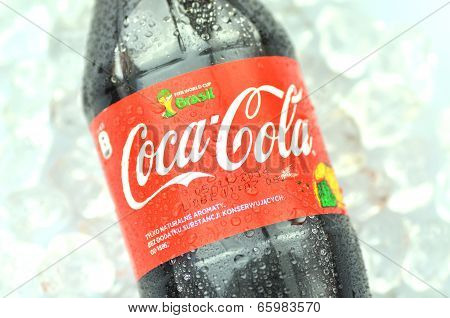 Bottle of Coca-Cola drink on ice