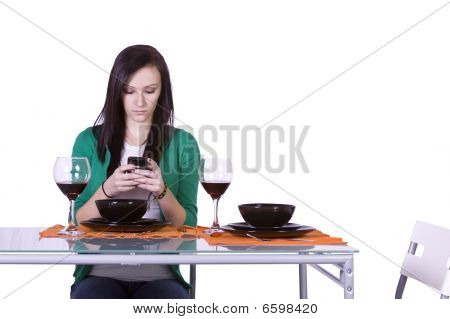 Beautiful Woman Texting At The Table