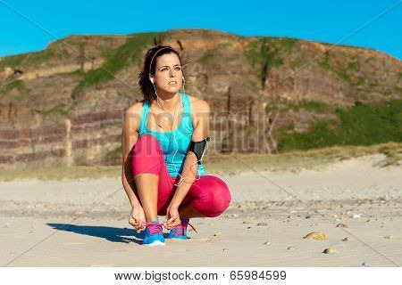 Female Runner Getting Ready For Training