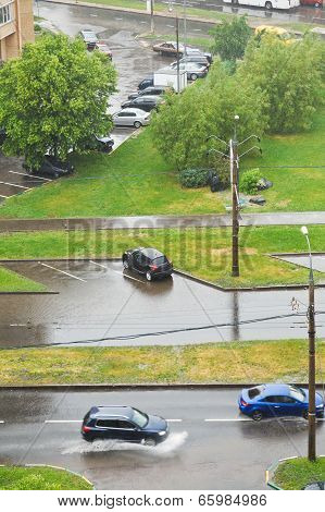 shower in city - urban street with cars under pouring rain poster