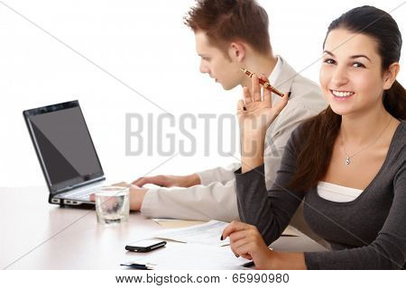 A businessgroup working at the table, isolated on white background