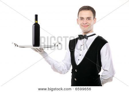 Battler Holding  A Silver Tray With A Wine Bootle On It