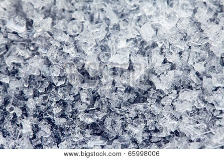 Ice Crystals Of Frozen Water On A Dark Surface