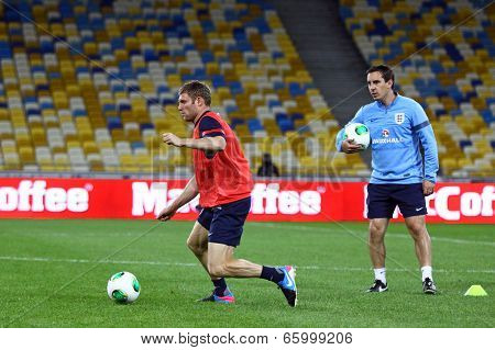 James Milner And Coach Gary Neville Of England