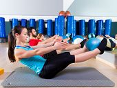 Pilates softball the teaser group exercise at fitness gym poster